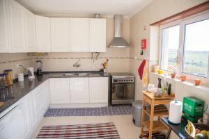 A kitchen or kitchenette at Alaia SurfLodge