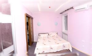 Кровать или кровати в номере Cозвездие Байкала