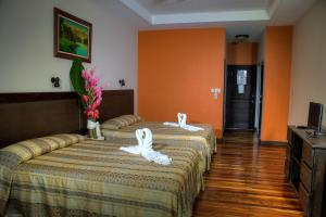 A bed or beds in a room at Hotel El Bambu