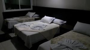 Кровать или кровати в номере Sokulski Flat Hotel e Restaurante