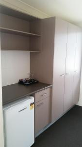 A kitchen or kitchenette at Dooleys Tavern and Motel Capella