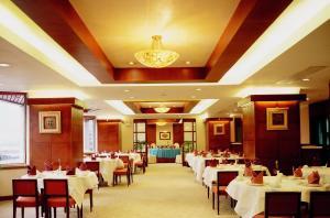 مطعم أو مكان آخر لتناول الطعام في فندق مدينة شنغهاي