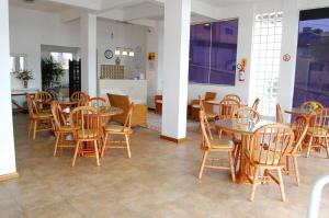 A restaurant or other place to eat at Apart Hotel Recanto das Pedras