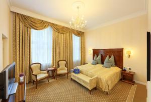 מיטה או מיטות בחדר ב-Hotel de France Wien