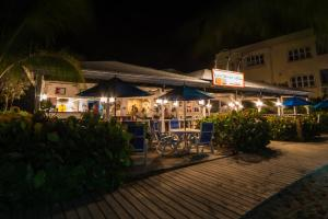 A porch or other outdoor area at The Hamilton Beach Villas & Spa