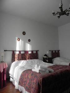 Cama o camas de una habitación en Hotel Beltran