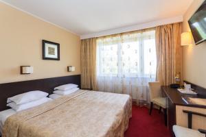 Ein Bett oder Betten in einem Zimmer der Unterkunft Hotel Rocca al Mare