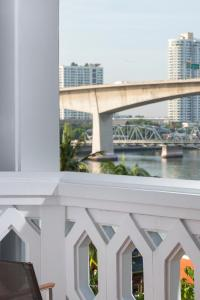 A balcony or terrace at Anantara Riverside Bangkok Resort - SHA Certified