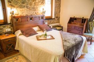 Cama o camas de una habitación en Hotel Rural Fontequeiroso