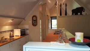 A kitchen or kitchenette at Arbor-Grove The Loft
