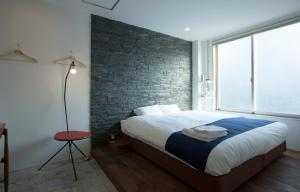 A bed or beds in a room at & AND Hostel