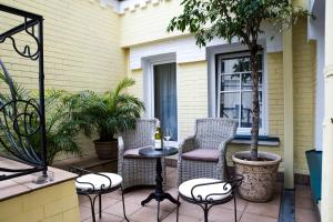 A porch or other outdoor area at Vozdvyzhensky Boutique Hotel