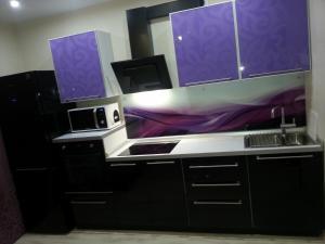 Кухня или мини-кухня в Apartments Amigos