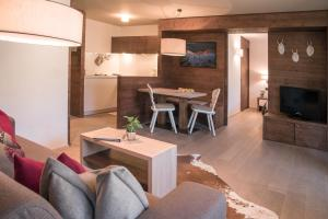 The lounge or bar area at Ariston Dolomiti Residence