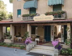 A patio or other outdoor area at Piccolo Hotel