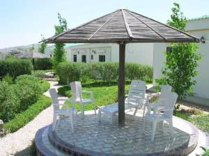 Uma varanda ou outra área externa em Raghdan Village