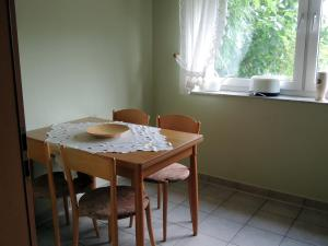 Ein Restaurant oder anderes Speiselokal in der Unterkunft Gästehaus Am Hirtenberg