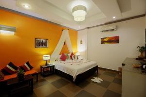 Ein Zimmer in der Unterkunft Areca Angkor Boutique Villa