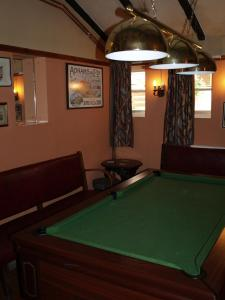 A pool table at The Olde Windmill Inn