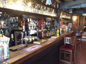 The lounge or bar area at The Olde Windmill Inn