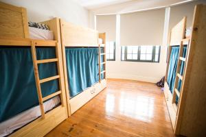 A bunk bed or bunk beds in a room at Nice Way Porto Hostel