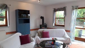 Ein Zimmer in der Unterkunft Ferienwohnung Holzquappe am Badesee Ehmetsklinge