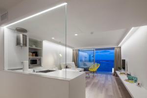 Küche/Küchenzeile in der Unterkunft Sud Ibiza Suites