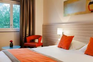 A room at Kyriad Hotel Strasbourg Lingolsheim