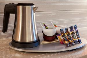Coffee and tea-making facilities at Kyriad Hotel Strasbourg Lingolsheim