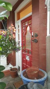 The facade or entrance of Edwardian Apartment Garden Flat