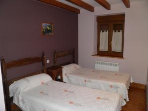Cama o camas de una habitación en Mirasierra II Y III
