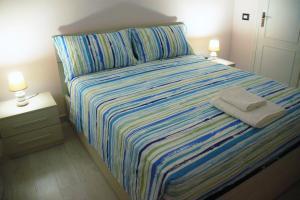 Un ou plusieurs lits dans un hébergement de l'établissement Hello Roma B&B