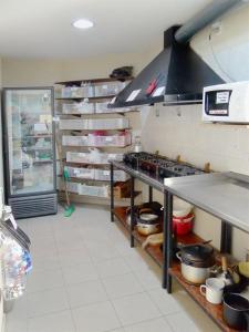 Una cocina o kitchenette en Patagonia Hostel
