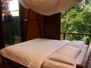A bed or beds in a room at Paganakan Dii Tropical Retreat