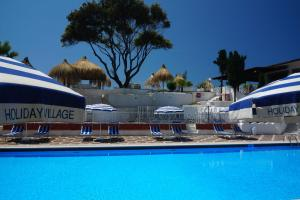 The swimming pool at or near Holiday Village