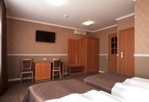 Кровать или кровати в номере Авент Инн Васильевский