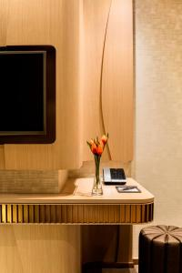 A television and/or entertainment center at Burlington Hotel