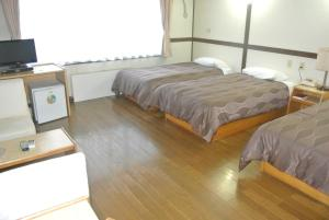 A bed or beds in a room at Hotel Biwako Plaza
