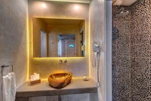 A bathroom at Nissaki Beach Hotel