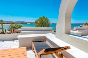 A balcony or terrace at Nissaki Beach Hotel