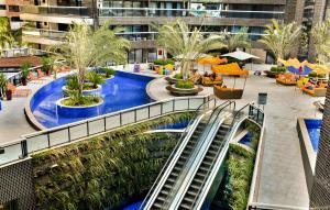 A piscina localizada em Apartamento na Beira Mar de Fortaleza - Edifício Landscape ou nos arredores