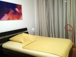 Ein Zimmer in der Unterkunft Art Apartment Scharitzerstraße
