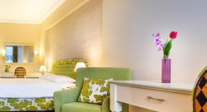 A bed or beds in a room at Airotel Alexandros