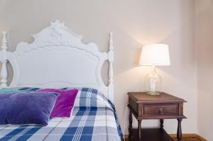 A bed or beds in a room at Chalet Monchique