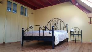 Een bed of bedden in een kamer bij Lant van Beloften