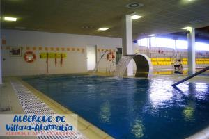 The swimming pool at or near Albergue de Villava