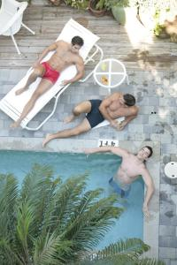 The swimming pool at or near Pineapple Point Guesthouse & Resort - Gay Men's Resort