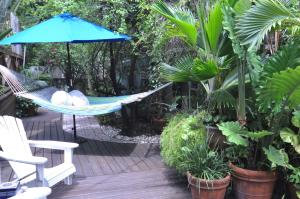 A porch or other outdoor area at Pineapple Point Guesthouse & Resort - Gay Men's Resort
