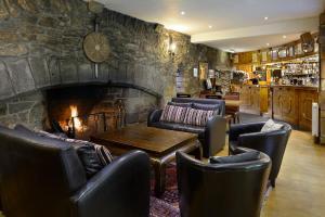 The lounge or bar area at Dornoch Castle Hotel