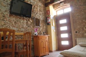 A television and/or entertainment center at Casa Llebra I